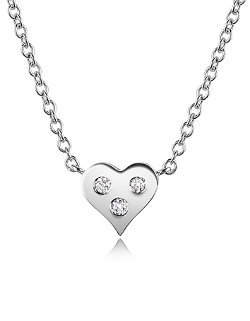 Perfect for any occasion or as a signature piece this glittering diamond trio set in a 18K white gold heart on a round link chain will steal any girl's heart. CTW 0.05; color G; clarity VS. Signature box included. Made in Italy.