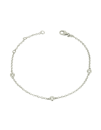 0.09 ct Diamond 18K Gold Bracelet adds a delicate feminine touch when worn alone or stacked next to an elegant watch. Featuring three sparkling diamonds interspersed on a delicate 18k white gold chain bracelet with lobster closure. Made in Italy.