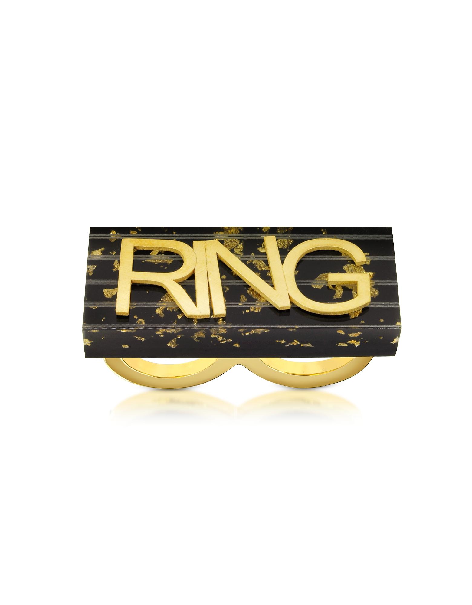 Ring in schwarz und gold